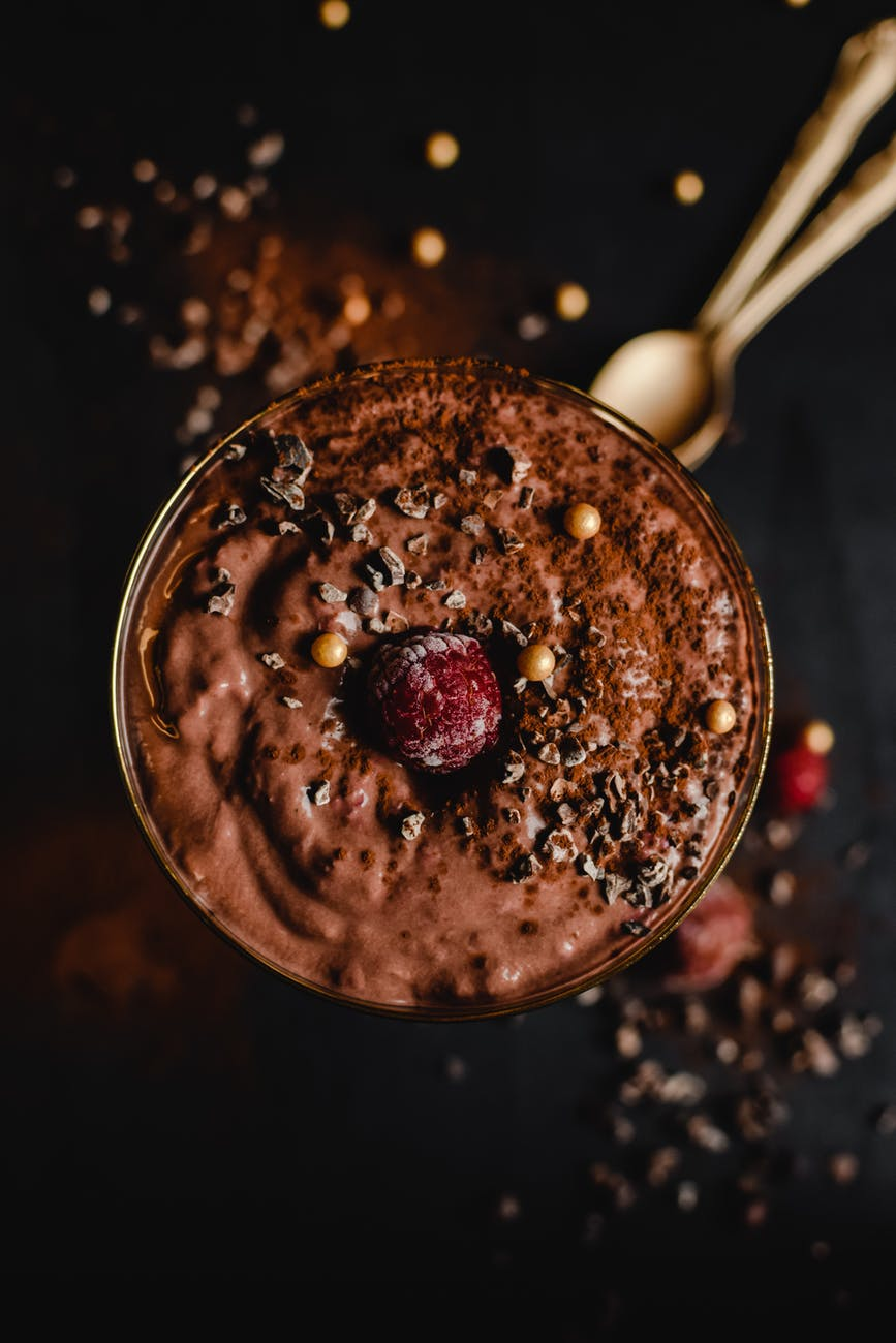 photo of chocolate smoothie with raspberry on top